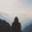 Man facing mountains